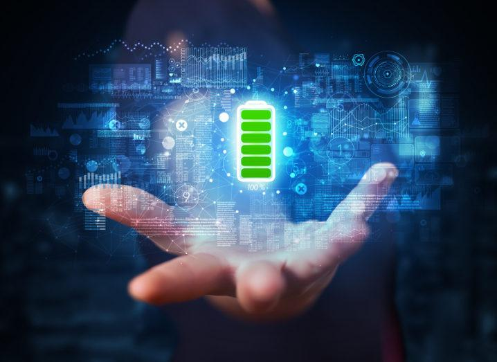 A hand reaches out and above it is a fully charged battery symbol, its energy powering multiple connections and devices.