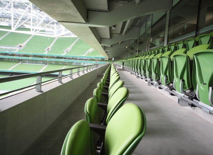 Long row of green fold-out seats in the Aviva Stadium in Dublin.