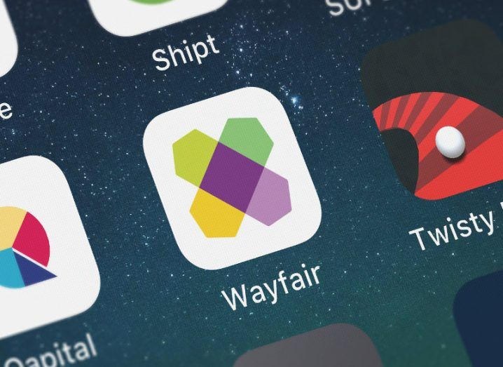 View of Wayfair mobile app icon on a menu on a smartphone screen.