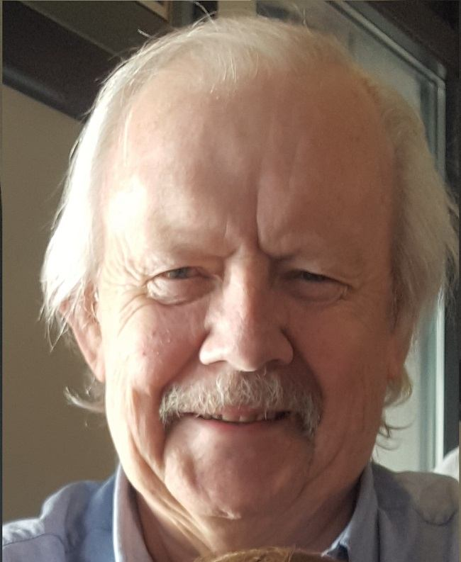 Headshot of Mike Tuthill smiling in 2017.