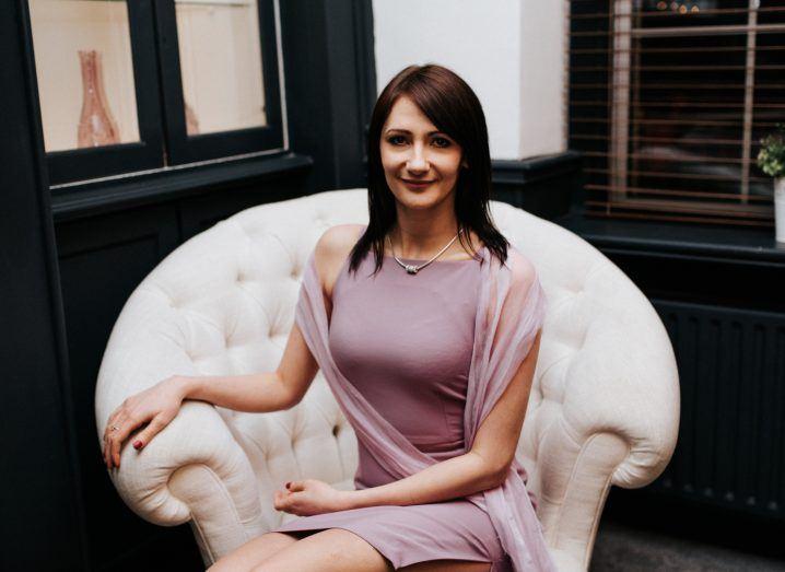 TurnedSee founder Pauline Kwasniak sitting in an armchair.
