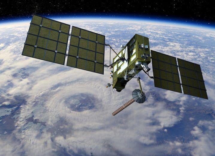 3D render of a GPS satellite in space in orbit above Earth.