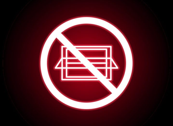 red neon logo of a laptop with a circle surrounding it and diagonal strike through, symbolising an internet ban.