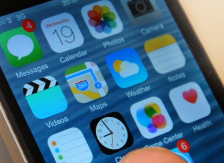 close-up of apple iphone with persons