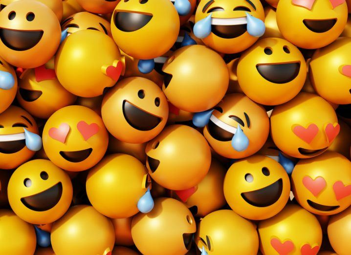 3d rendering of yellow emoji faces with different expressions all bundled together.