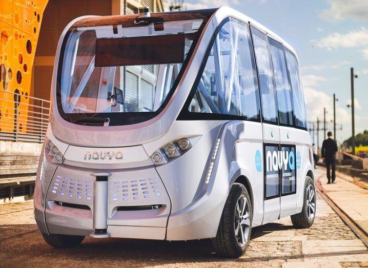 A silver Navya autonomous shuttle bus.