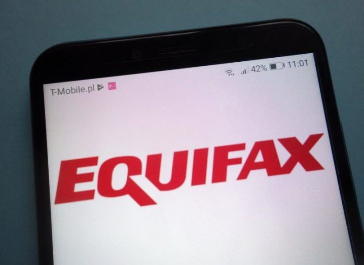 The red Equifax logo on a white background, displayed on a mobile phone.