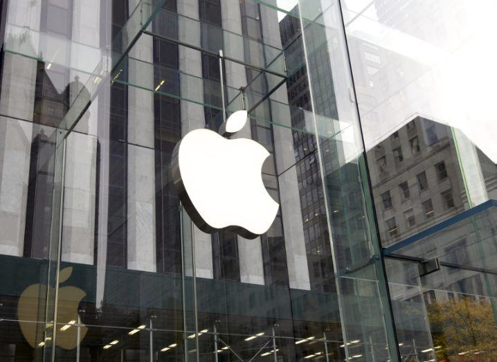 Apple logo on store front with shimmering glass façade in metropolitan city centre.