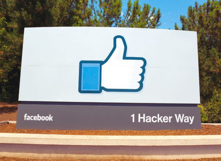 View of sign saying 1 Hacker Way with iconic thumbs up logo at Facebook California headquarters.