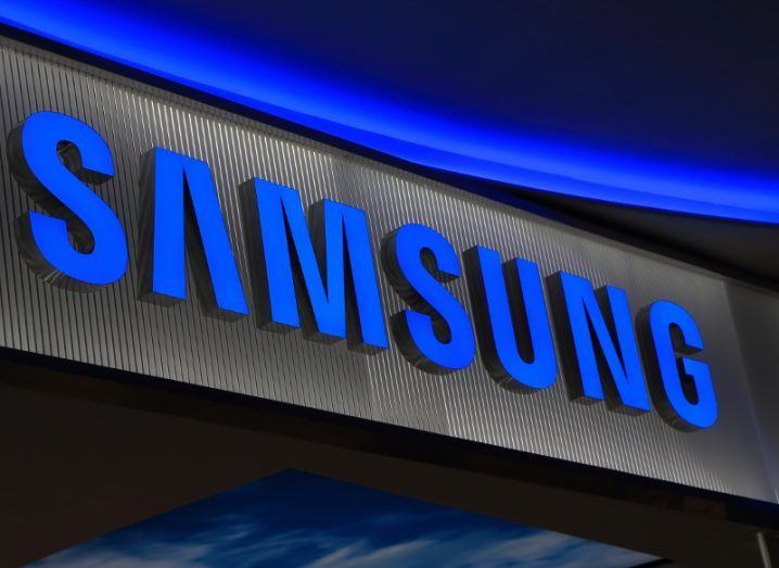 View of Samsung logo illuminated in electric blue.