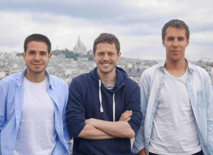 Joko's three founders standing beside each other, with a view overlooking Paris.