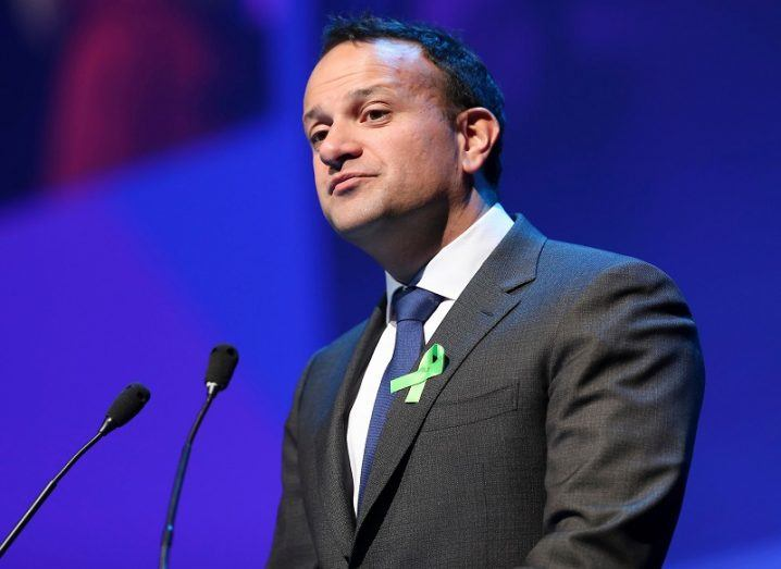 Leo Varadkar in a dark grey suit, white shirt and blue tie on stage at Inspirefest 2019.