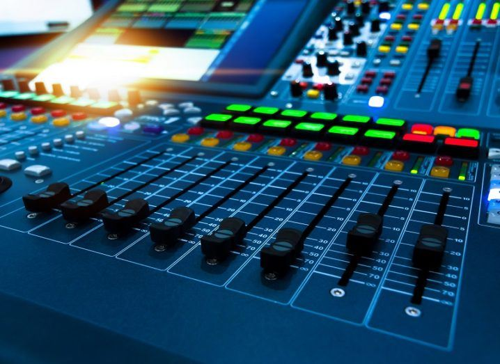 Brightly coloured radio mixing desk, focusing on the various levels.