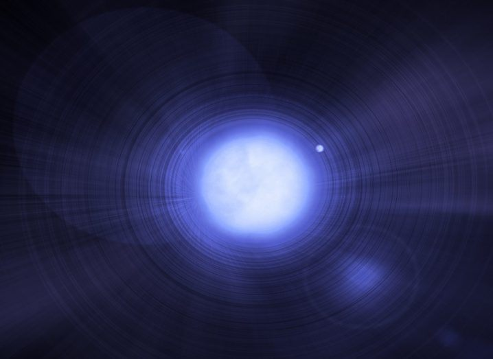 A white dwarf glowing a blueish-white colour.