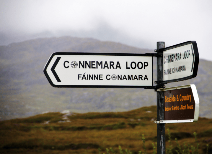 A road sign pointing to the Connemara Loop, in Ireland's Connemara region where Irish is the primary language.