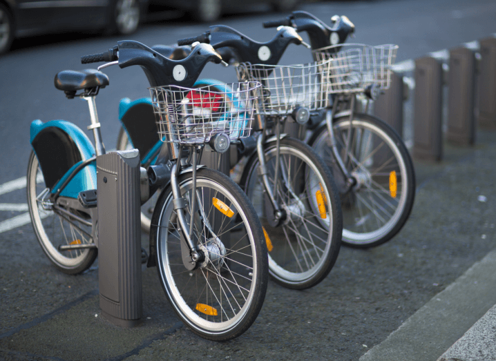 Dublinbikes parked at a station on a Dublin street.