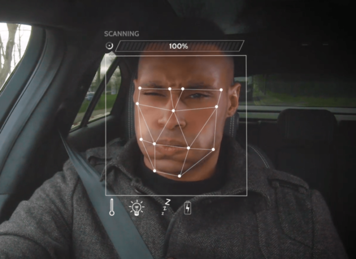 Facial recognition technology picks up the face of a man in the driver's seat of a Jaguar Land Rover car.