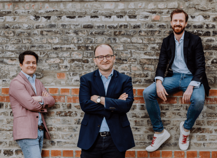 Raisin's founding team. Three caucasian men stand in front of a brick wall, wearing sports jackets and jeans.