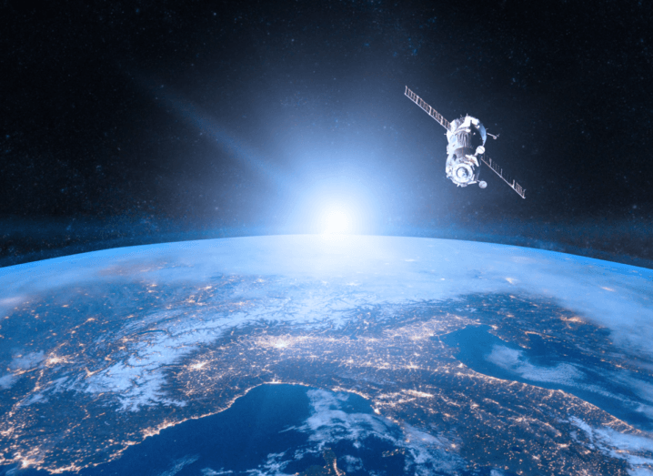 A satellite in orbit over Earth.