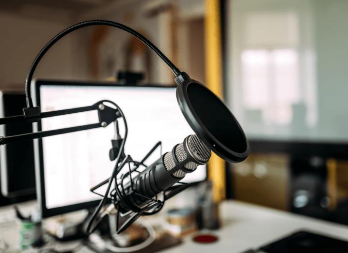 A microphone in a podcast studio.