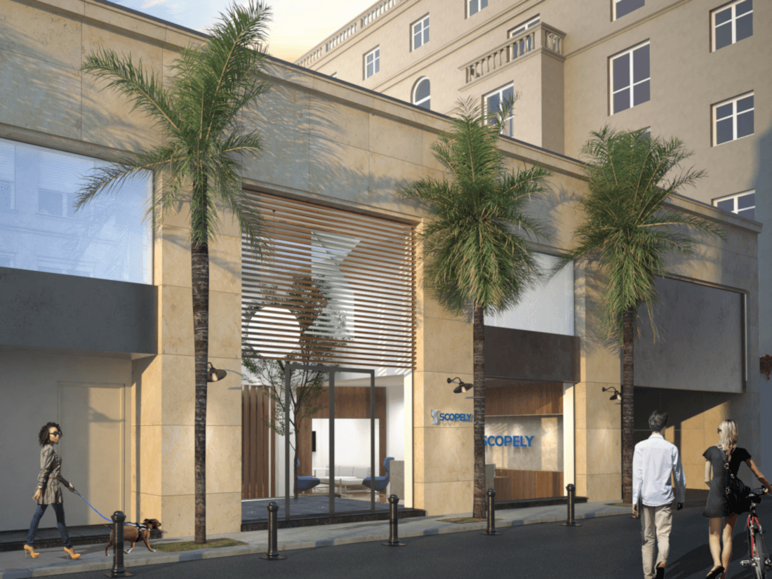 A rendering of a modern office building with beige tiles on the outside and three palm trees lined up outside of it.