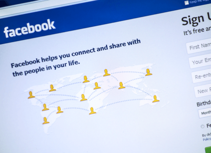 The login page for Facebook. It has a blue header and a white background. There are cartoon people connected all around the world on it.