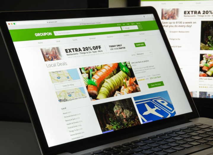 A browser window displaying Groupon's green and white website, which features special offers and deals.