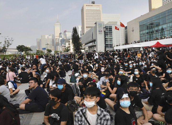 Large street protest in Hong Kong marching.