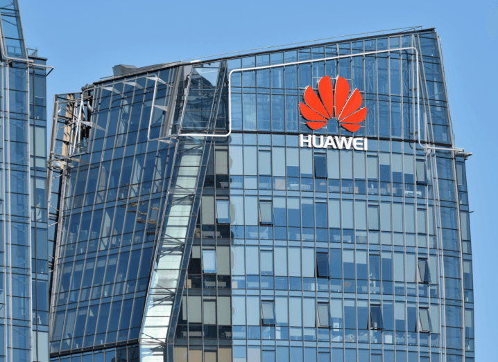 Huawei's tall, glass offices, in front of a blue sky.