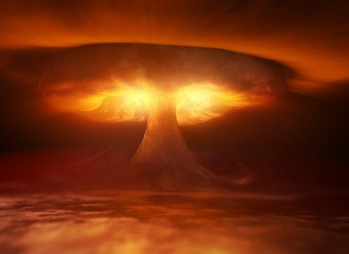 3D render of huge nuclear mushroom cloud coloured orange.