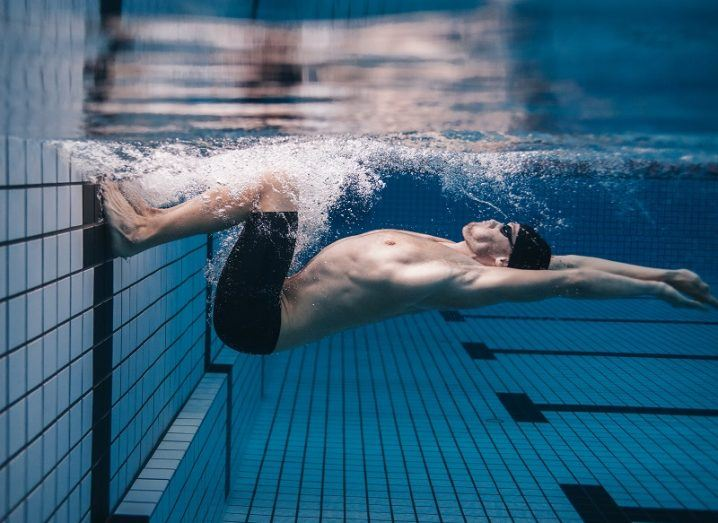Underwater shot of elite swimmer launching from the end of the pool.