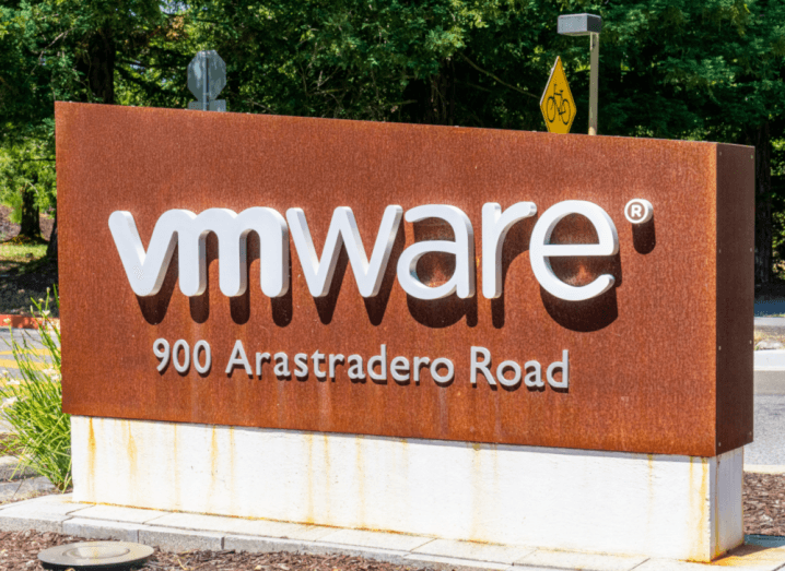 A red metal sign outside that reads VMware.
