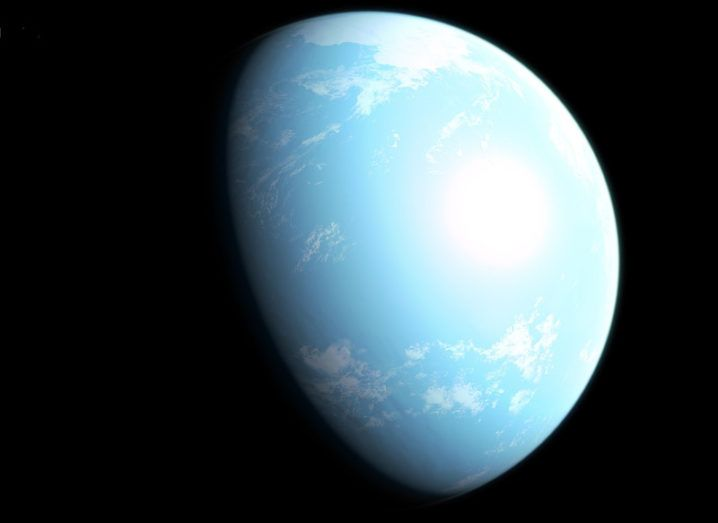 A sky-blue planet partly in shadow with a sprinkling of clouds across its surface.