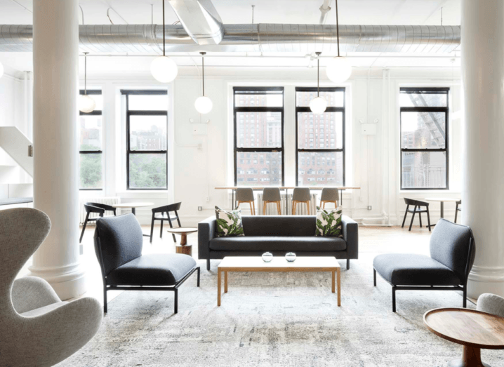 A bright, modern Knotel workspace, with minimalist furniture and large windows.