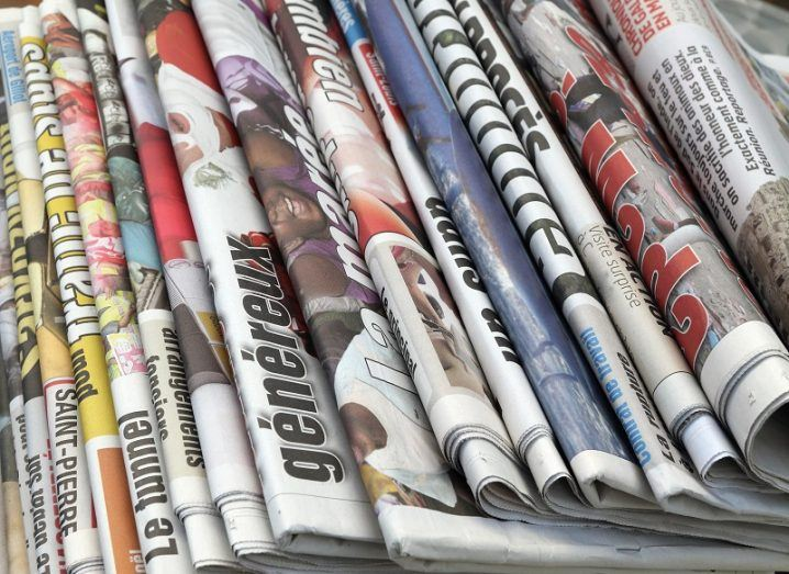 Line of newspapers folded in half.
