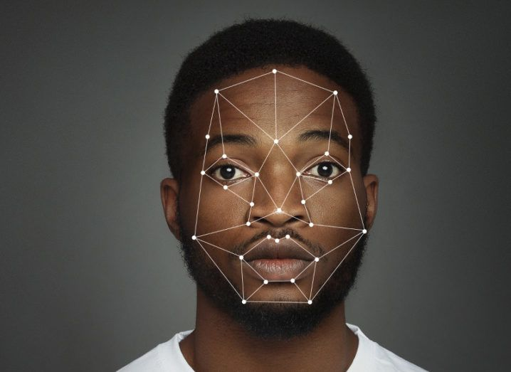 A headshot of a man overlaid with markers from a facial recognition scan.