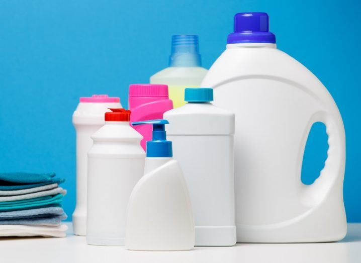 Number of bleach bottles and wipes against a blue background.