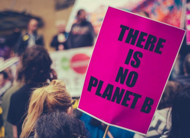 Pink sign at a climate protest that reads there is no planet B.