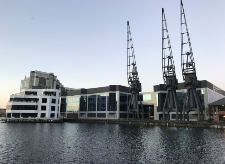 View of Echelon data centre in London, beside body of water on bright day.