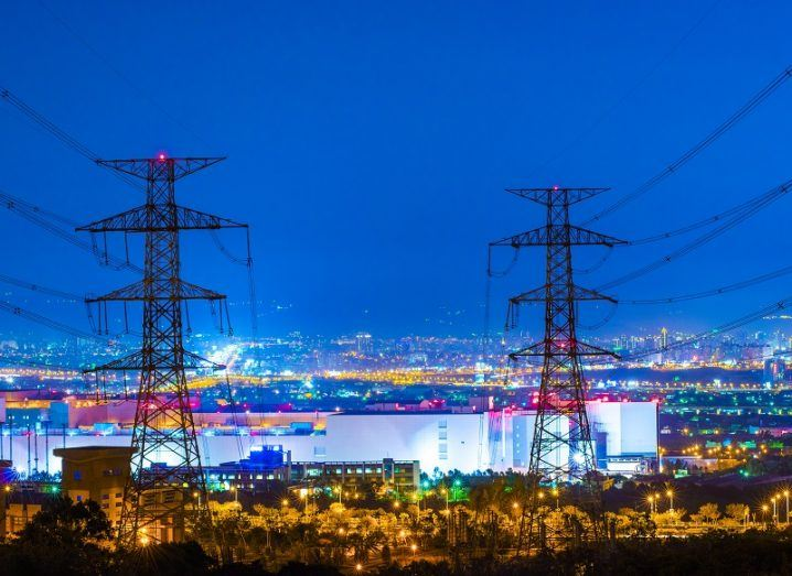 Electricity pylons powering a city at night.
