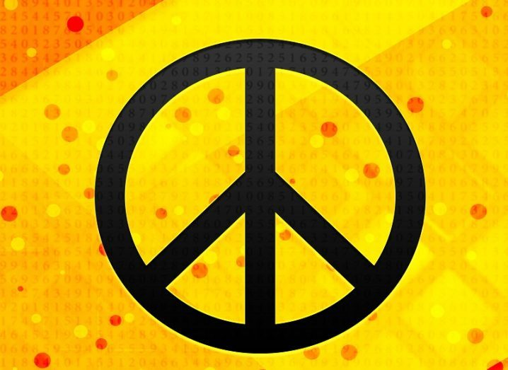 Black peace sign against a yellow background emblazoned with binary code.