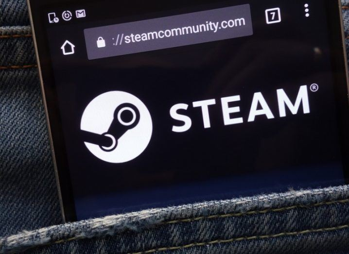 A phone with the Steam webpage open in a jeans pocket.