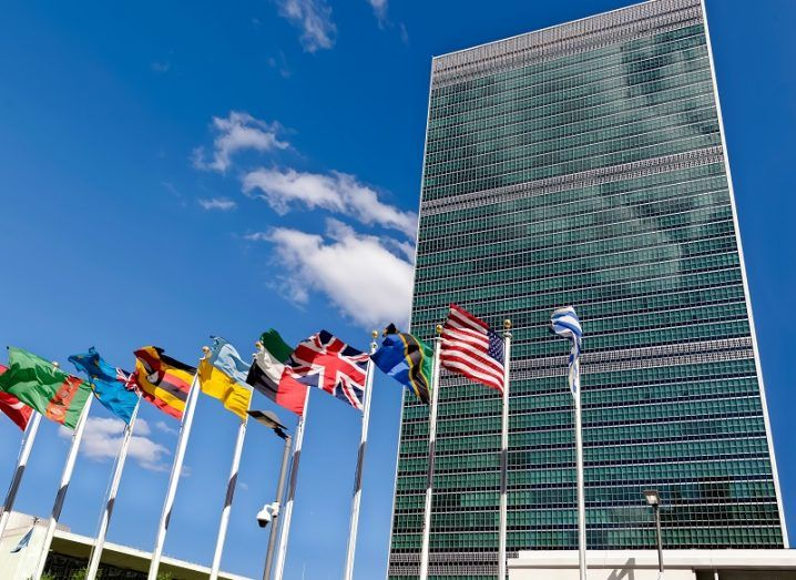 The UN headquarters with member nation flags out front.