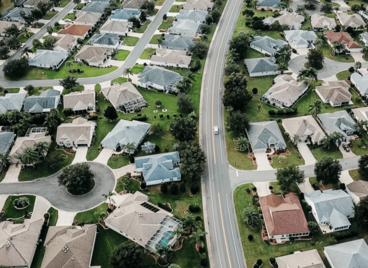 An aerial view of a complex neighbourhood with cul de sacs and smaller roads connected to a larger road.
