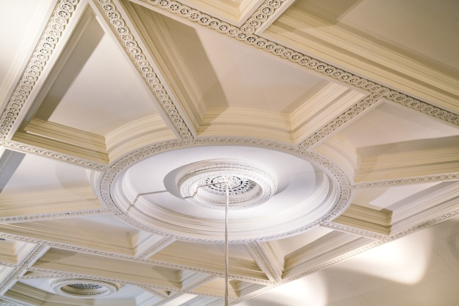 A decorative, old-fashioned white ceiling