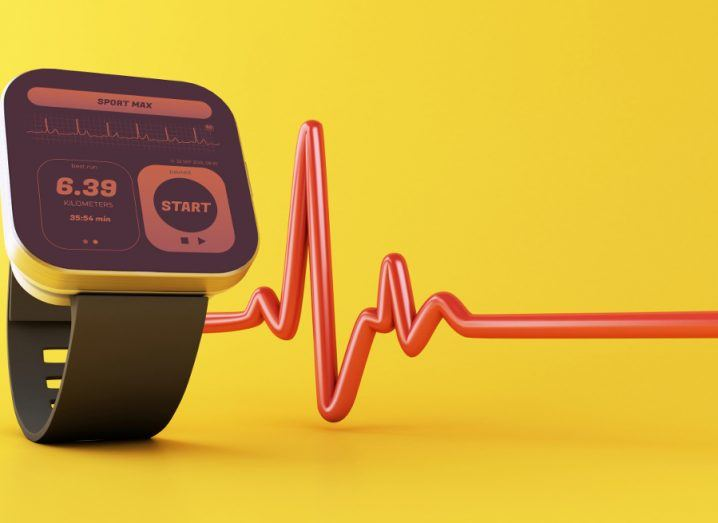 Smart watch with health app icon and a red lifeline against a yellow background.
