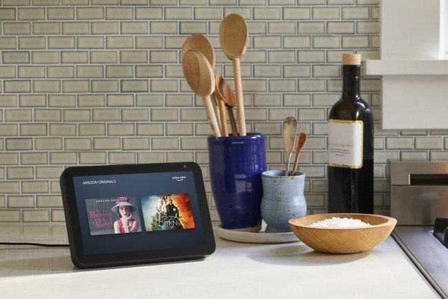 A portable screen displaying Amazon Prime Video content pictured on a countertop next to some kitchen utensils.