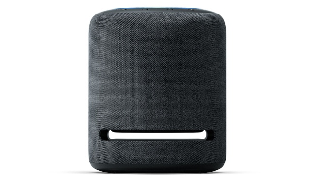 A squat cylindrical speaker covered in a charcoal mesh with a an open slit near the base.