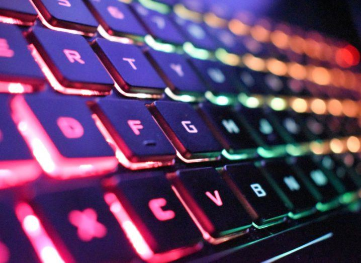 View of keyboard illuminated with rainbow lights.