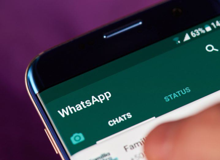 View of green and white display of WhatsApp app loaded up on smartphone screen.